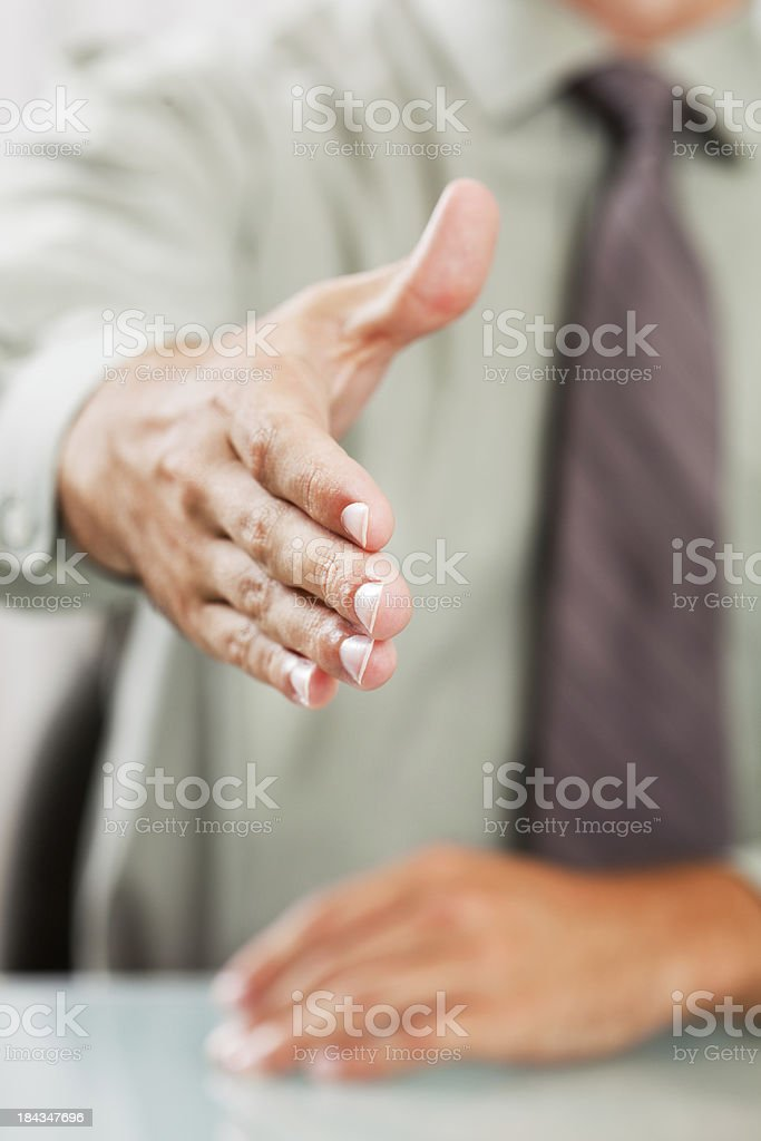 Friendly Approachable Businessman Extending Hand for Handshake royalty-free stock photo