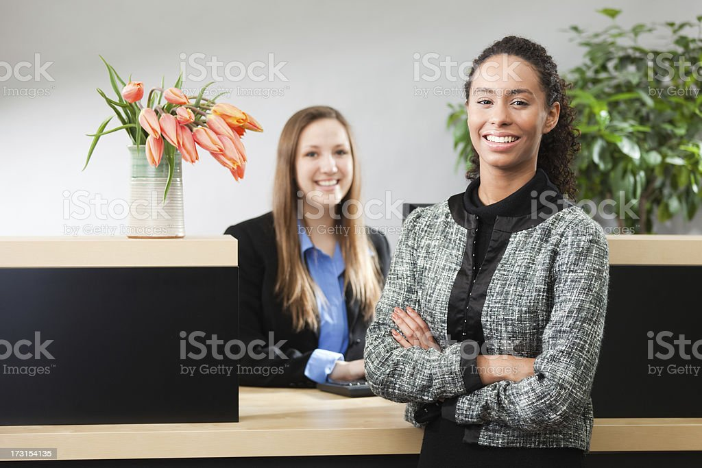 Friendly Bank Manager and Teller in Banking Counter Window Hz royalty-free stock photo