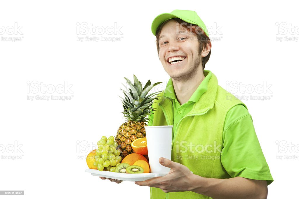 Friendly Bartender in Green Uniform Holding a Tray with Fruits. royalty-free stock photo