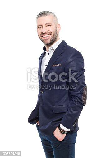 istock Friendly bearded grey hair elegant businessman 506754248