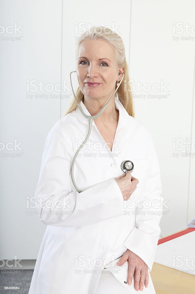Friendly blond female doctor royalty-free stock photo