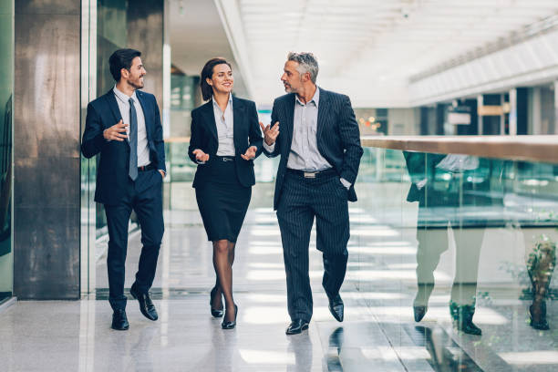 friendly business discussion - woman suit stock photos and pictures