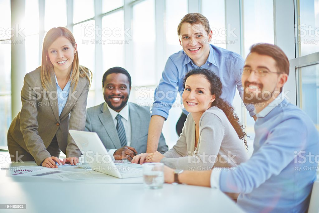 Modern business people sitting at workplace