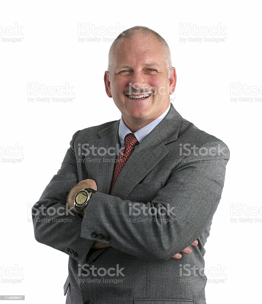 Friendly Businessman Standing With His Arms Crossed Stock
