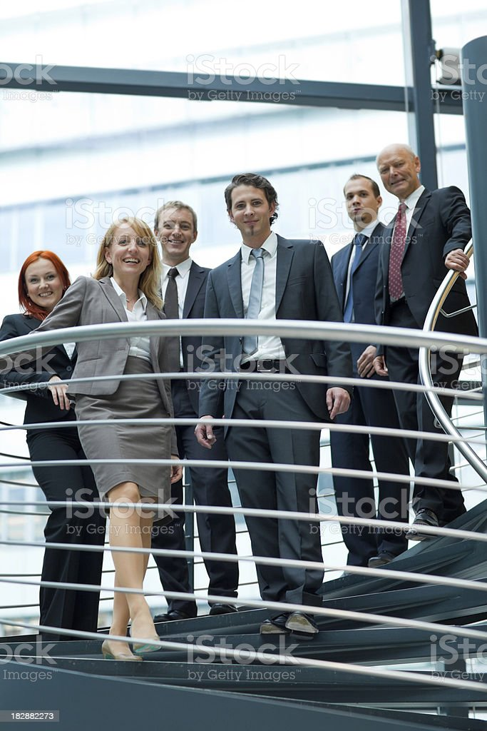 friendly businessteam walking down stairs royalty-free stock photo
