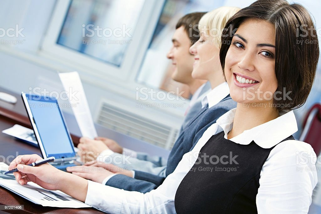 A friendly businesswoman taking part in a meeting royalty-free stock photo