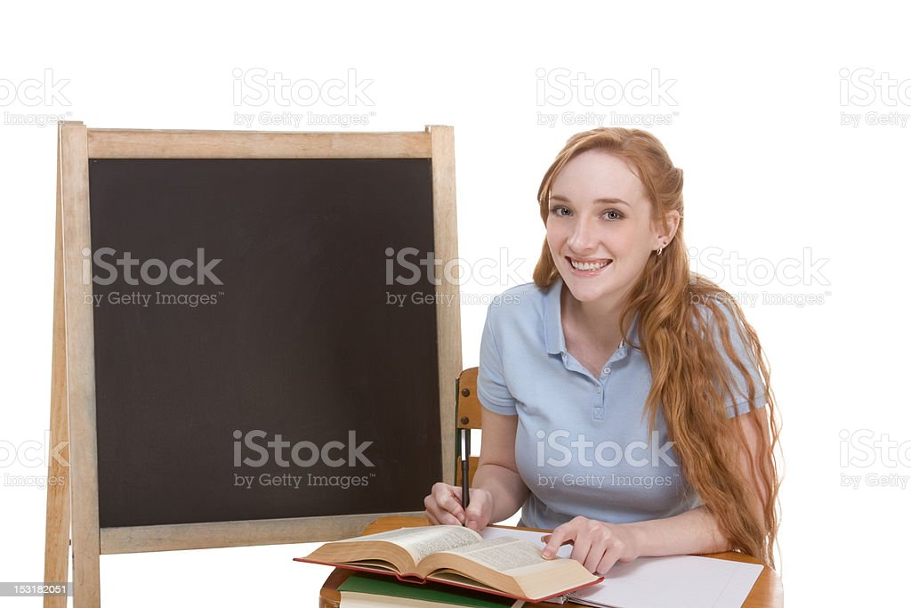 Friendly Caucasian college student by blackboard royalty-free stock photo