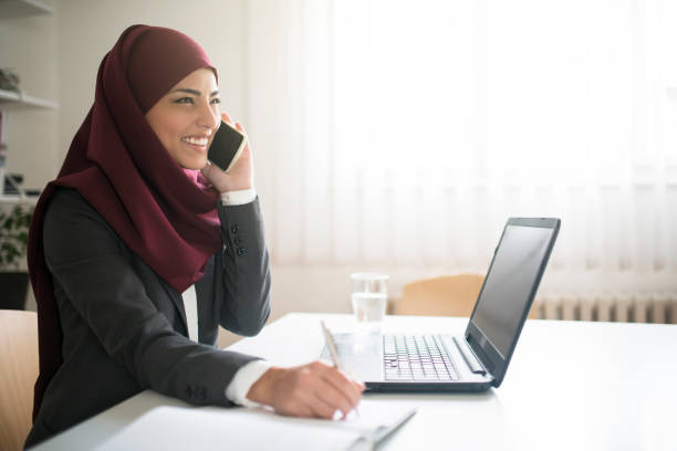 friendly cooperation with clients - saudi woman stock photos and pictures