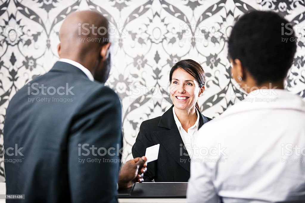 Friendly couple checkin at hotel stock photo