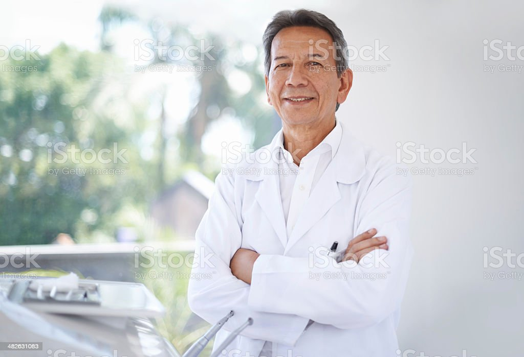 Friendly face of your family dentist stock photo