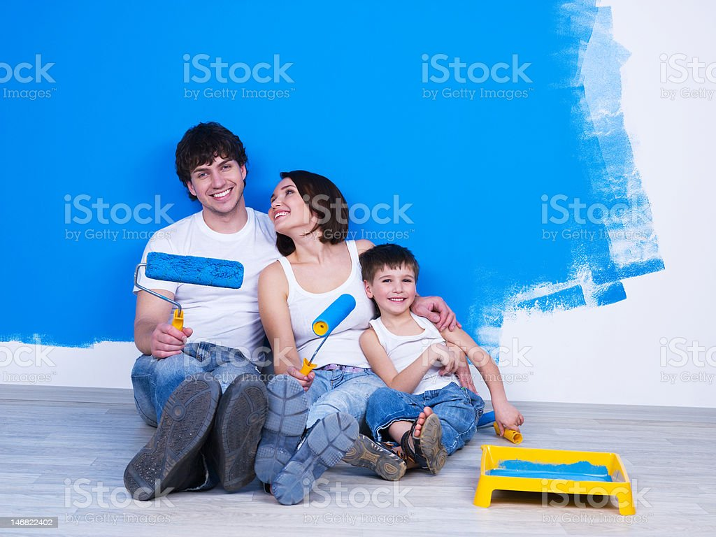 Friendly family doing renovation stock photo