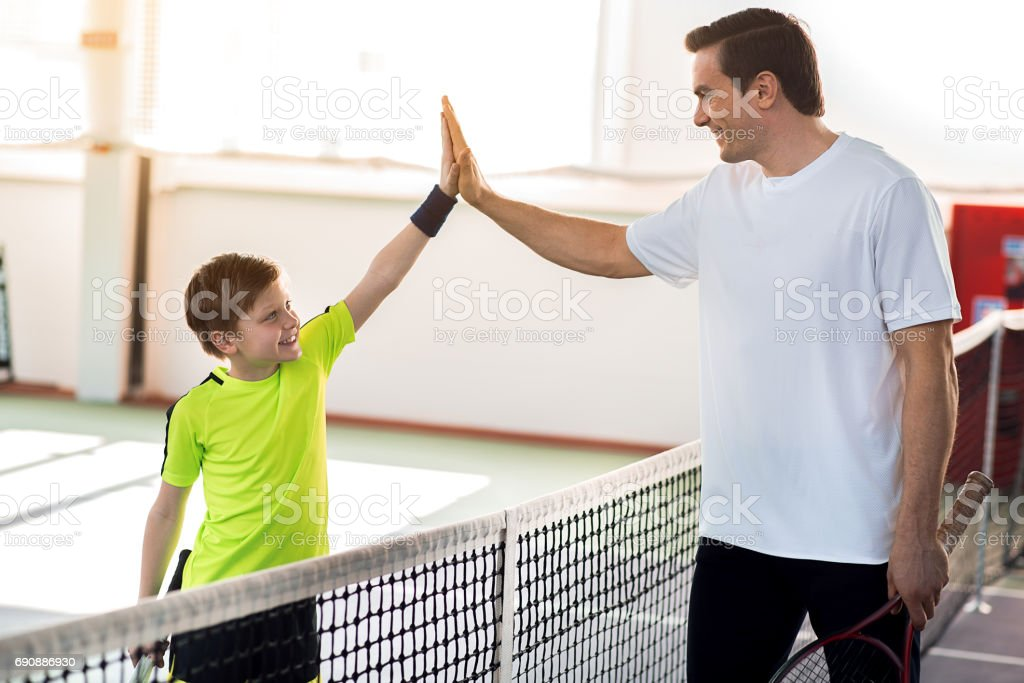 Friendly family going for sports together stock photo