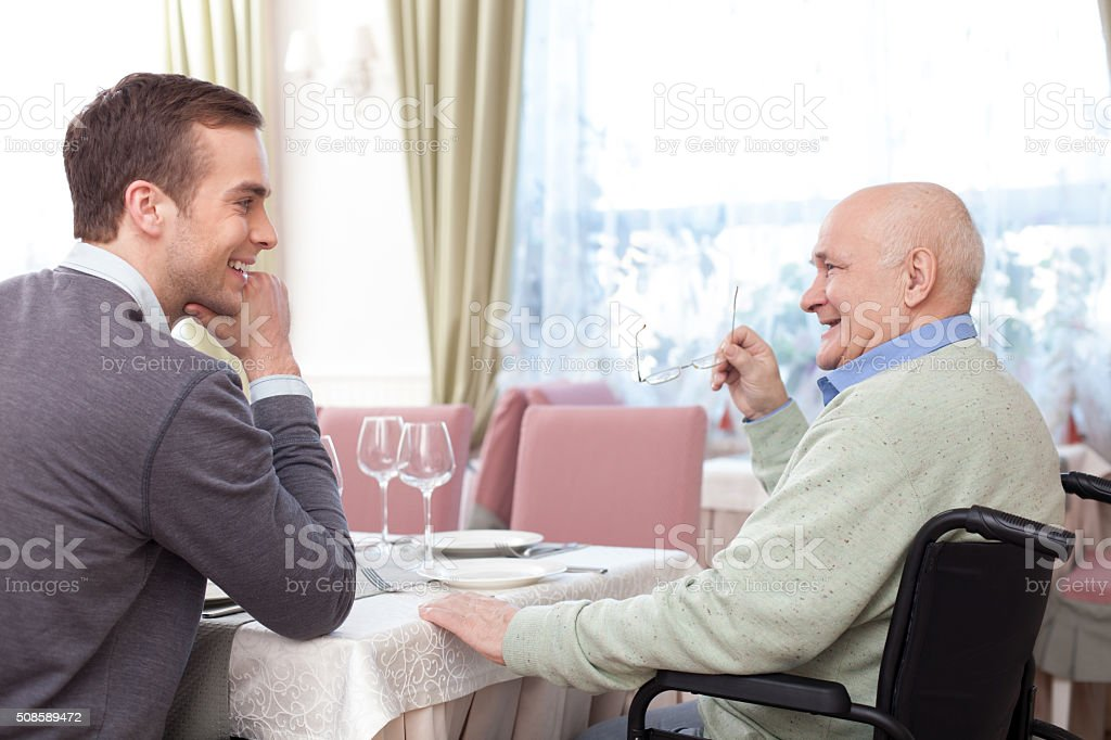 Friendly family is resting in cafe stock photo