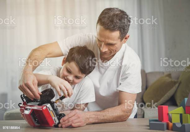Friendly family repairing toy car at home picture id976188954?b=1&k=6&m=976188954&s=612x612&h=dszca03cse23u7yrdmiwzf3ddqs36lucosjf8ivchyu=
