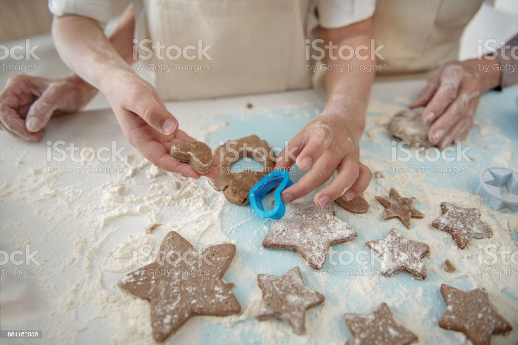 Friendly family sculpting form of cookies together royalty-free stock photo
