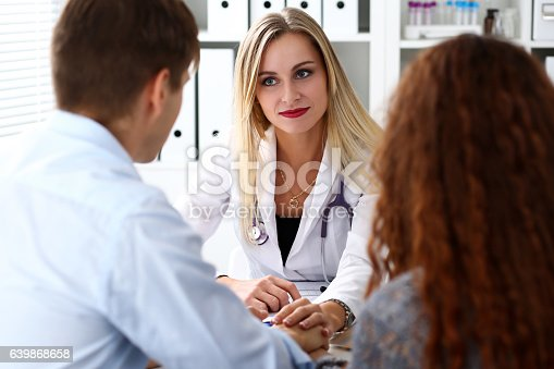 1021670950istockphoto Friendly female doctor hold patient hand 639868658
