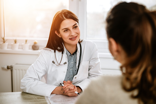 istock Friendly female doctor listening to a female patient 925831304