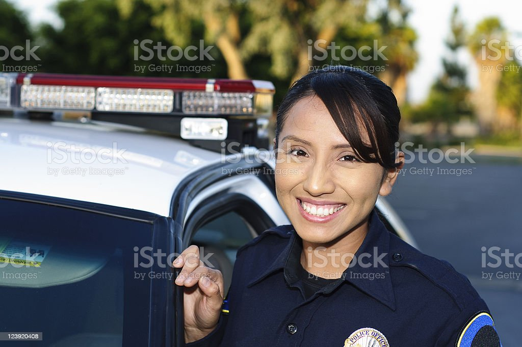Friendly female Hispanic police officer stock photo