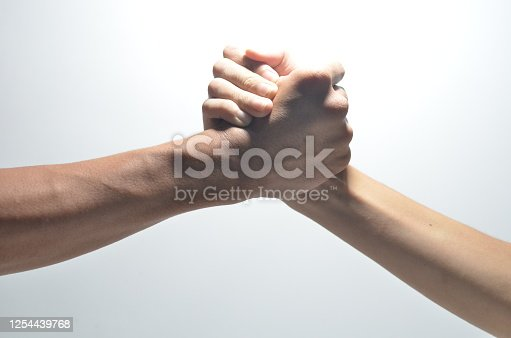 Friendly handshake, friends greeting, teamwork, friendship on isolated white bcakground