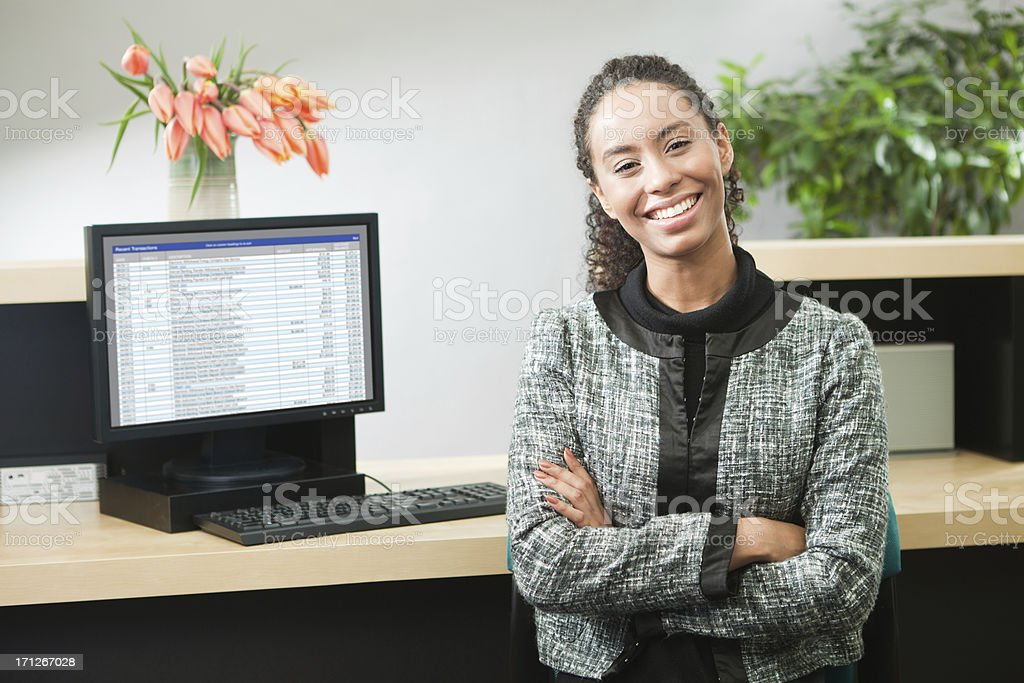 Friendly Happy Bank Teller at Work in Banking Counter Hz stock photo