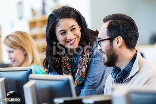istock Friendly Hispanic woman talking with college classmate 469036490