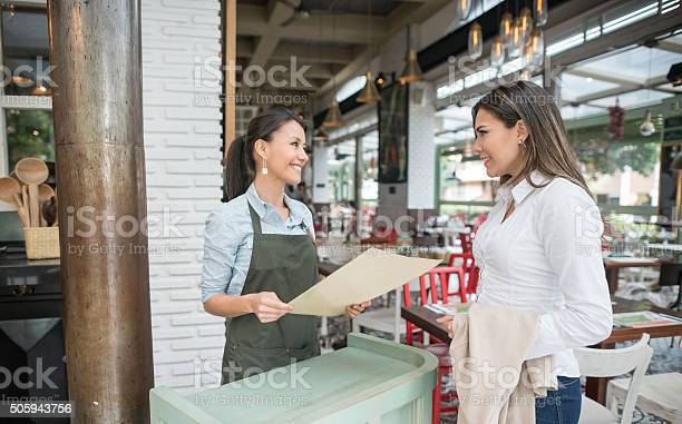 Friendly hostess working at a restaurant picture id505943756?b=1&k=6&m=505943756&s=612x612&h=tgnki75qk2 n6cgtq1i82mtydknxn0ojbd1oynpsdea=