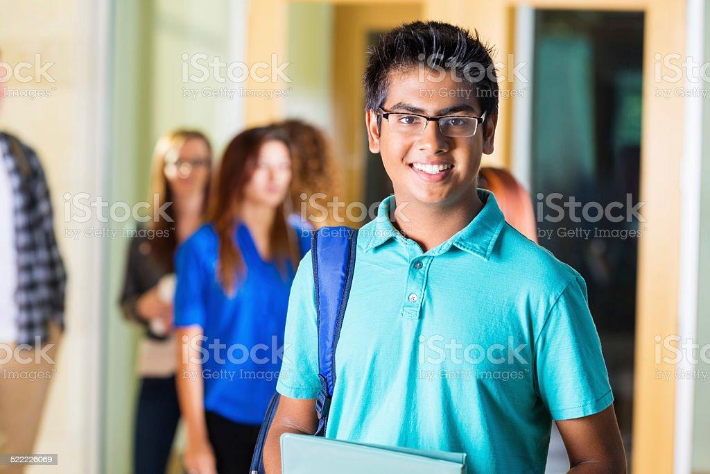Friendly Indian high school student smiling in hallway stok fotoğrafı