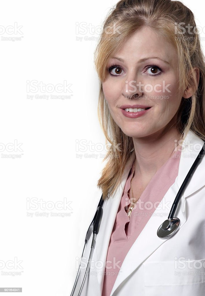 Friendly lady doctor on white background royalty-free stock photo