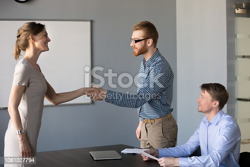 istock Friendly male hr welcoming female applicant at interview with handshake 1061027794