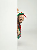 istock friendly man dressed like a funny gnome posing on an isolated gray background 1067071382
