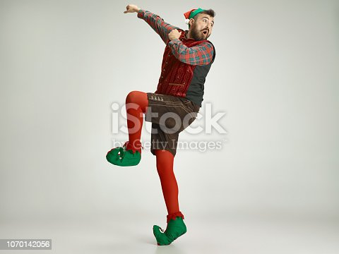 istock friendly man dressed like a funny gnome posing on an isolated gray background 1070142056