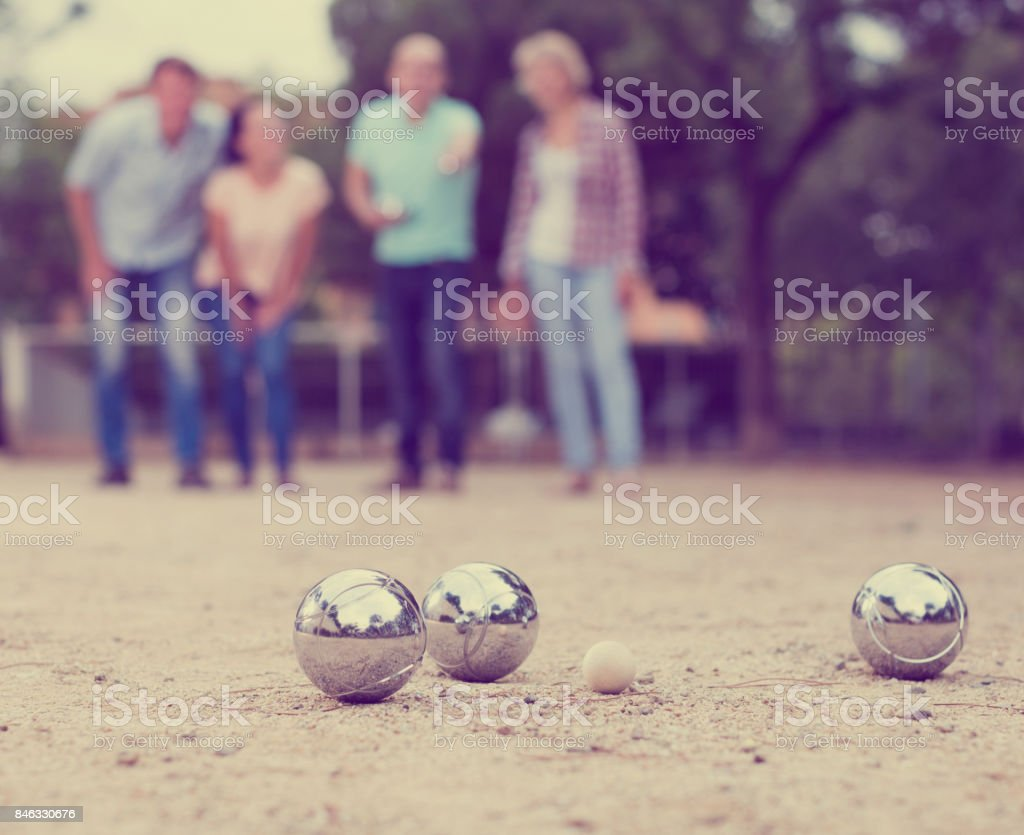 friendly mature couples playing petanque at leisure stock photo