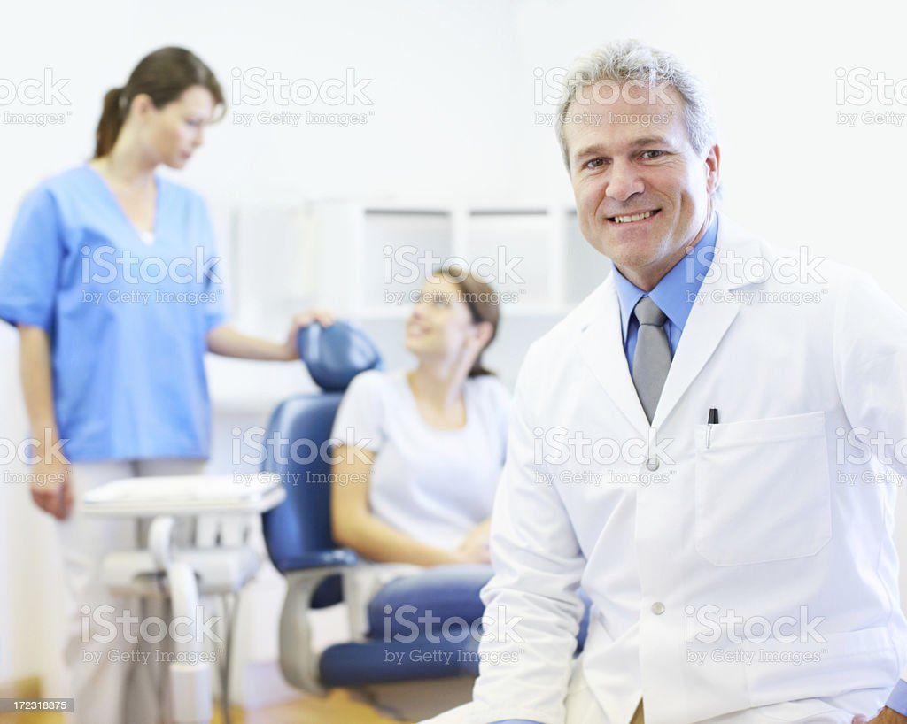 Friendly mature dentist royalty-free stock photo