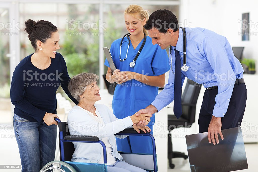friendly medical doctor greeting senior patient royalty-free stock photo