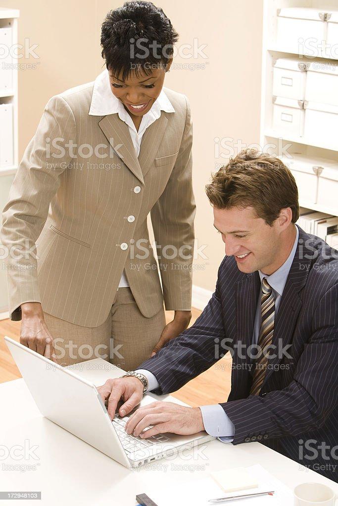 Friendly Meeting Around Laptop royalty-free stock photo