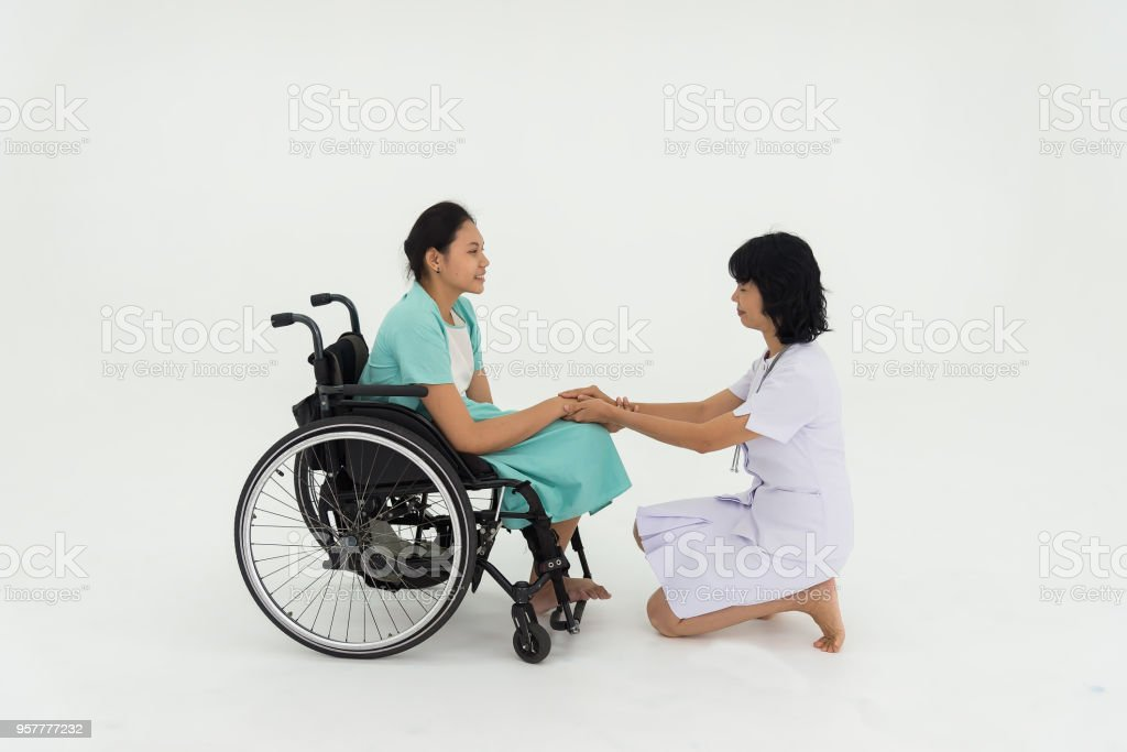 Friendly nurse greet patients with disabilities. stock photo