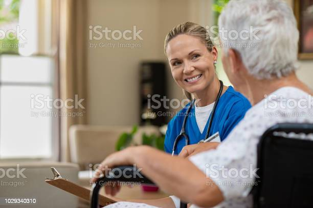 Friendly nurse talking to senior patient picture id1029340310?b=1&k=6&m=1029340310&s=612x612&h= 9h wolwcbju3uvclsqphnav3amz1dd8 qwobstbmw4=
