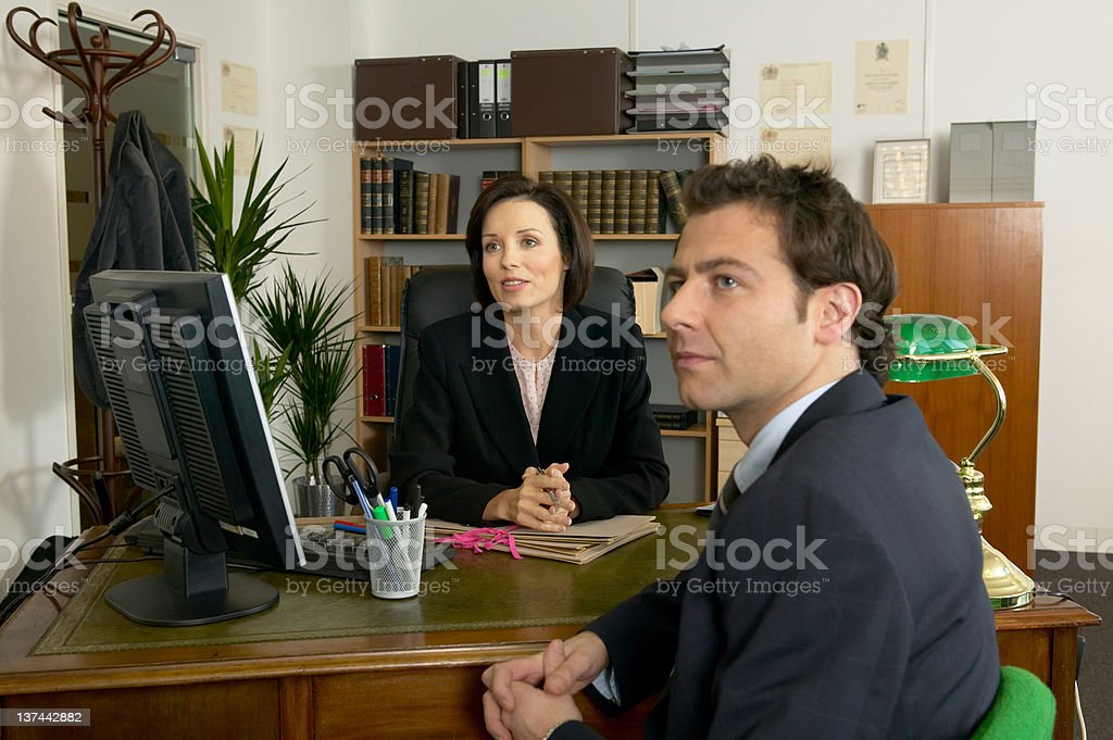 Friendly Office Discussion royalty-free stock photo