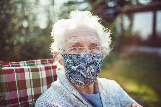 Friendly old senior wears a mask to protect against viruses and bacteria Friendly old senior wears a mask to protect against viruses and bacteria homemade stock pictures, royalty-free photos & images