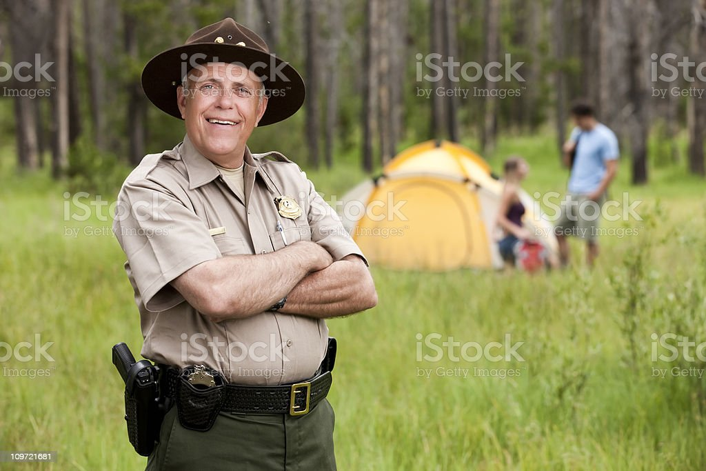 Friendly Park Ranger at Campsite stock photo