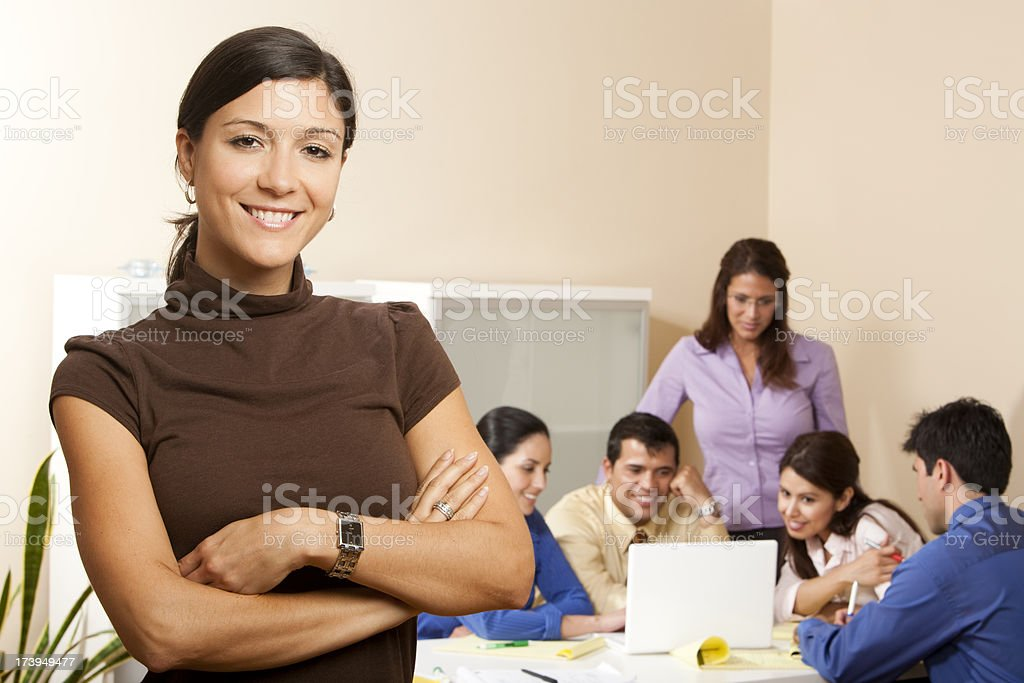 Friendly Professional Female and Team royalty-free stock photo