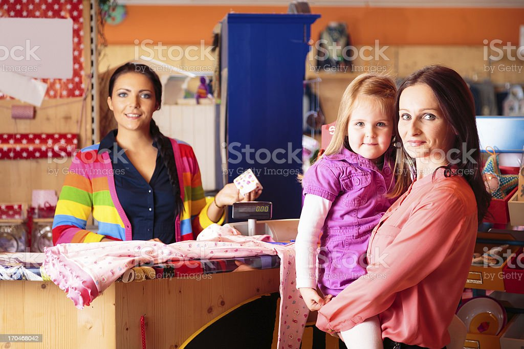 friendly sales person at children's store royalty-free stock photo