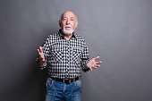 istock Friendly senior man welcoming you copy space 843214020