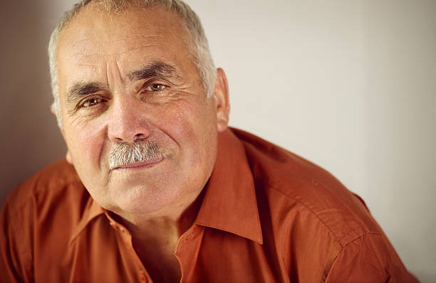 Friendly senior man with a moustache stock photo