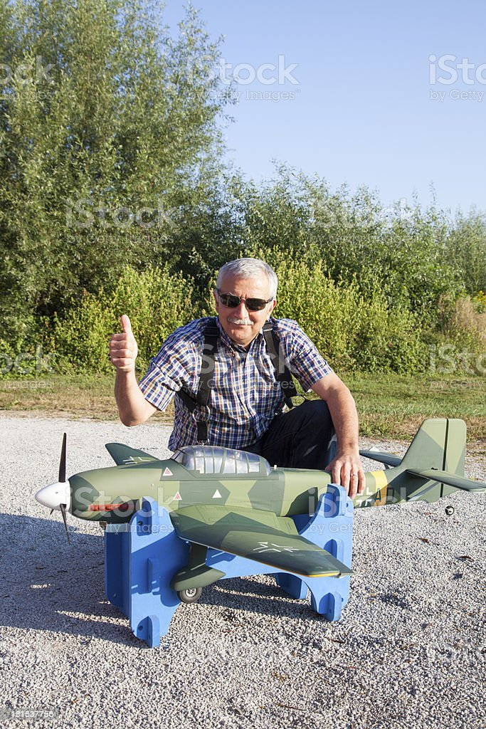Friendly senior RC modeller and his new plane model royalty-free stock photo