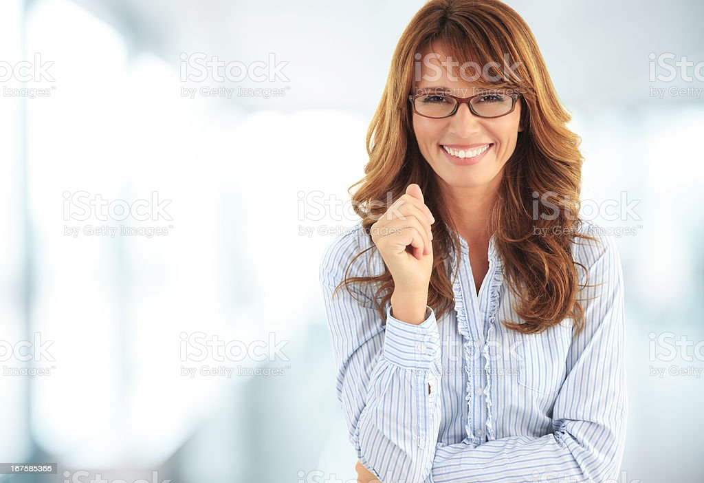 Friendly smile of a beautiful businesswoman stock photo