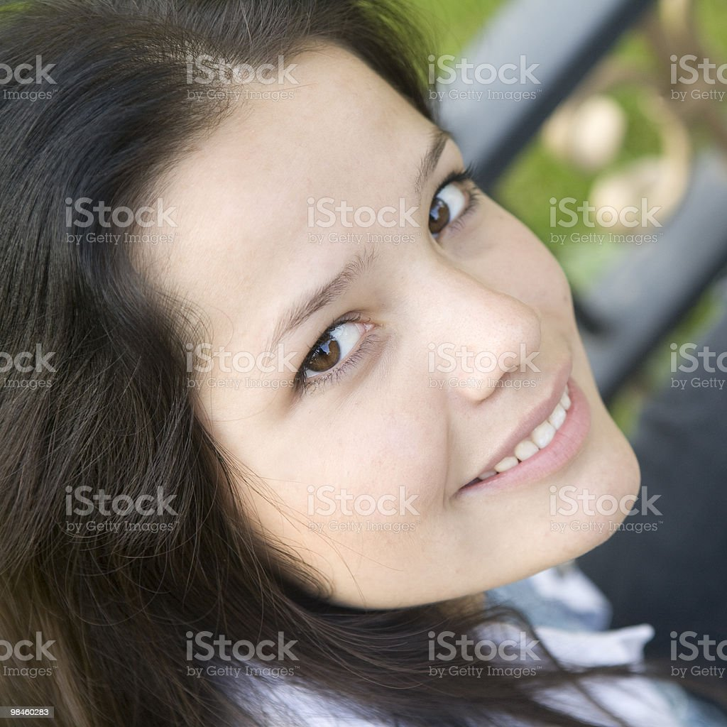 Friendly Smile, woman at the park stock photo