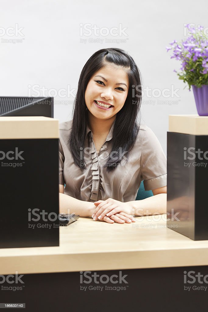 Friendly Smiling Asian Retail Banking Bank Teller Vt royalty-free stock photo