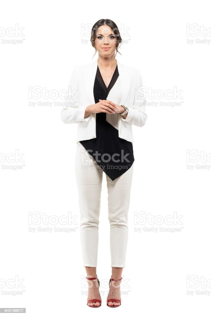 Friendly smiling business female presenter in formal suit with hands clasped looking at camera stock photo