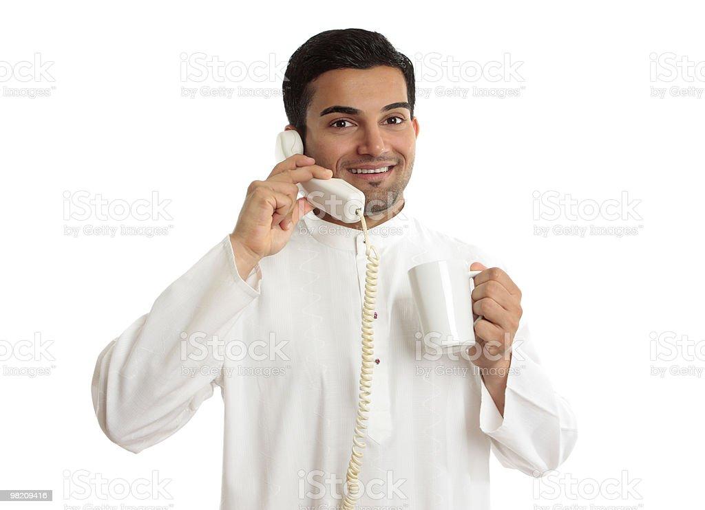 Friendly smiling ethnic businessman on telephone royalty-free stock photo